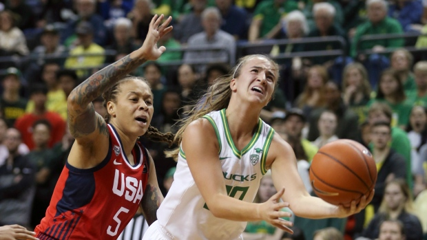 Sabrina Ionescu, right, goes up for a shot ahead of United States' Seimone Augustus