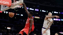 Pascal Siakam, left, dunks past Kyle Kuzma (0)