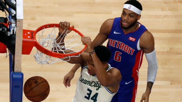 Giannis Antetokounmpo (34) dunks as Bruce Brown (6) watches