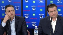 Jim Benning Travis Green