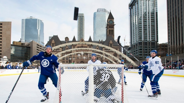 Leafs players watch the puck sail over the net Thursday at Nathan Phillips Square.