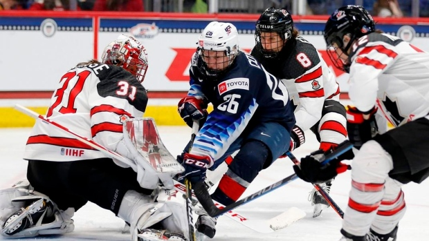 Canada's Genevieve Lacasse (31) blocks a shot by United States' Kendall Coyne Schofield (26)