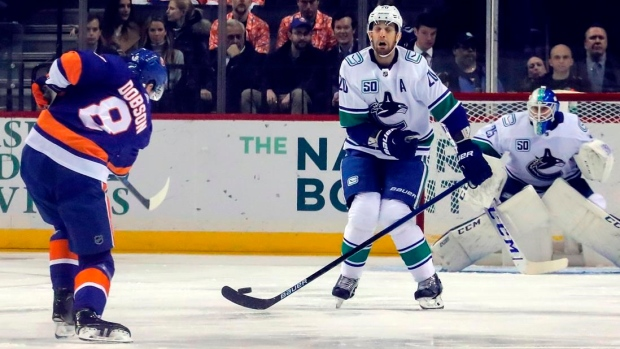Hughes, Schaller lead Canucks past Islanders 4-3 Article Image 0