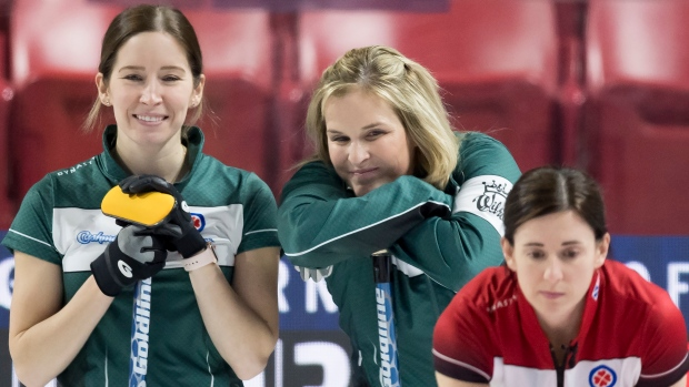 Skip Jennifer Jones, centre, and third Kaitlyn Lawes look on during Wednesday competition.