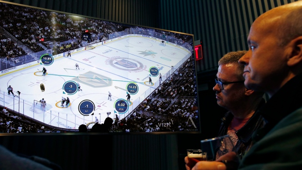 People watch real-time puck and player tracking technology