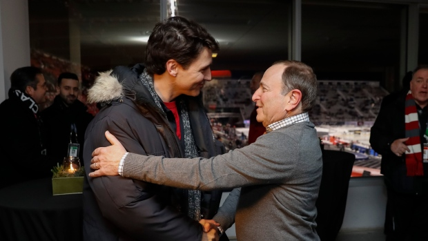 Prime Minister of Canada Justin Trudeau greets NHL Commissioner Gary Bettman