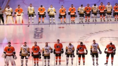 Flyers, Penguins stand for anthem