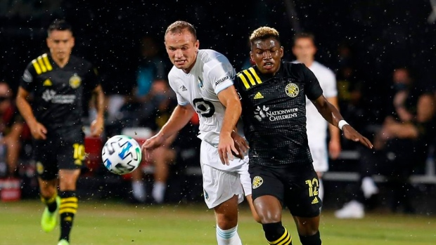 Minnesota United defender Chase Gasper and Columbus Crew midfielder Luis Diaz