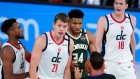 Washington Wizards' Moritz Wagner (21) and Milwaukee Bucks' Giannis Antetokounmpo (34)