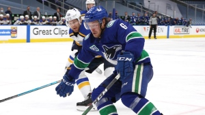 Canucks activate Boeser, place Petan on waivers