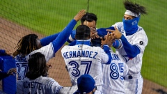 Alejandro Kirk and his Toronto Blue Jays teammates celebrate