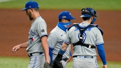 Blue Jays manager Charlie Montoya, center, takes relief pitcher A.J. Cole out against the Rays