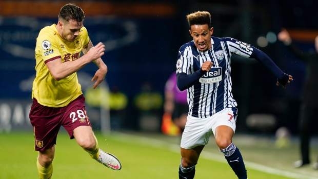 West Brom's Callum Robinson and Burnley's Kevin Long