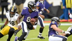 Baltimore Ravens' Lamar Jackson (8) runs against the Pittsburgh Steelers
