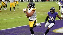 Pittsburgh Steelers' Chase Claypool, center left, makes a touchdown catch against Baltimore Ravens