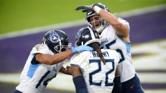 Tennessee Titans running back Derrick Henry celebrates with teammates