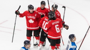 Cozens scores twice as Canada defeats Finland to win group