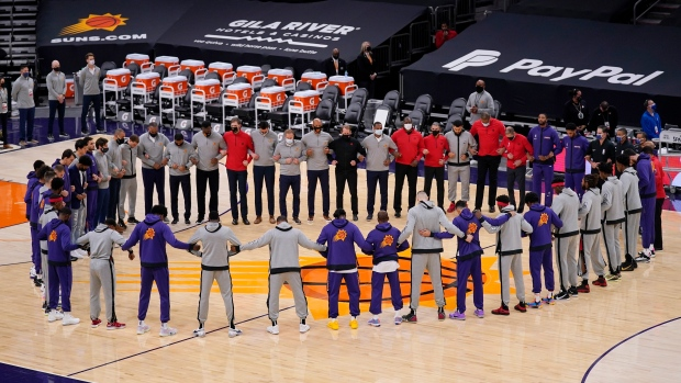 Phoenix Suns and the Toronto Raptors form a circle