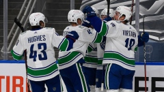 Quinn Hughes Elias Pettersson Travis Hamonic Jake Virtanen Brock Boeser Canucks