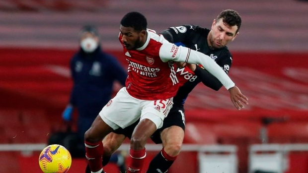 Crystal Palace's James McArthur, right, tries to stop Arsenal's Ainsley Maitland-Niles