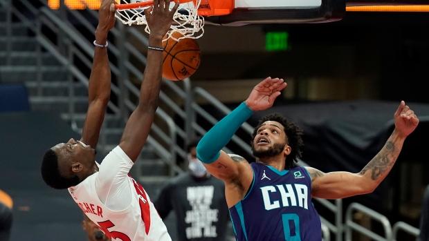 Boucher, Raptors hold off Hornets for third win