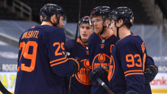 Leon Draisaitl talks with Connor McDavid, Tyson Barrie, and Ryan Nugent-Hopkins