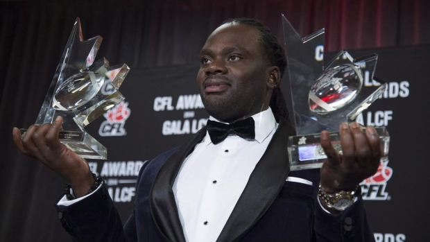Solomon Elimimian with Most Outstanding Player, Most Outstanding Defensive Player trophies