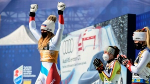 Suter wins downhill for her first gold at worlds