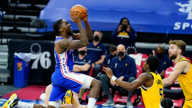 76ers' Shake Milton goes up for a shot against Pacers