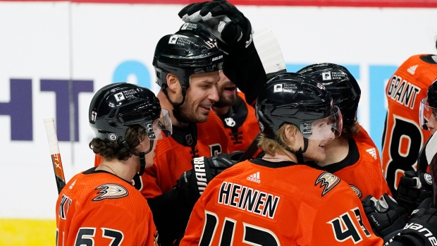 Ryan Getzlaf celebrates with teammates