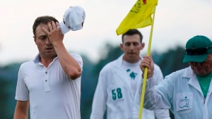 On a suddenly soggy day at Augusta, some fail to adjust