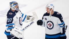 Connor Hellebuyck and Dylan DeMelo