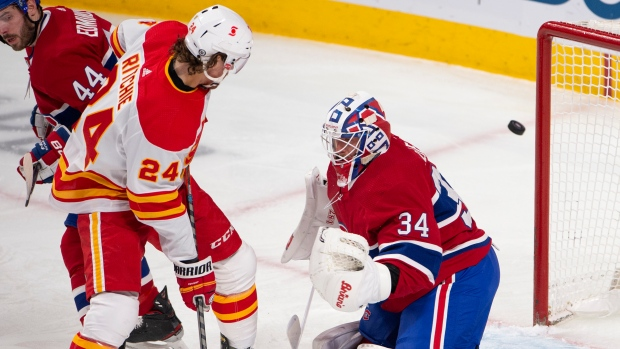 Montreal Canadiens' Jake Allen and Calgary Flames' Brett Ritchie