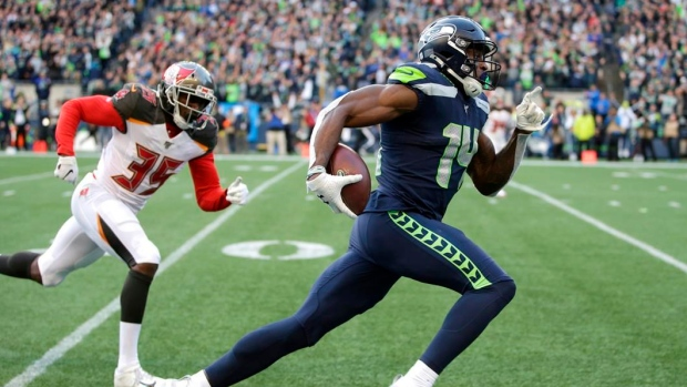 Seahawks WR Metcalf 'focused on football' after running 100m dash