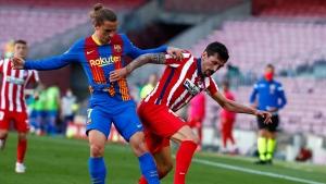Atlético draws with Barcelona and keeps Liga lead