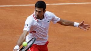 Djokovic rolls past Cuevas into third round