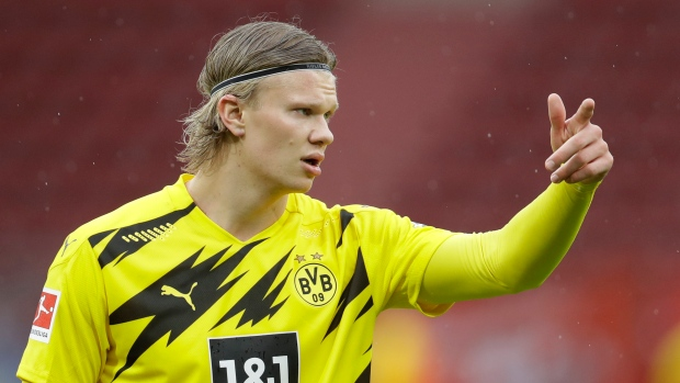 Dortmund secures Champions League spot with win at Mainz