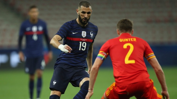 Benzema misses penalty in comeback as France beats Wales
