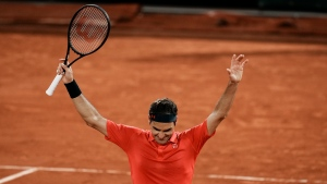 Federer struggles past Koepfer to reach French Open last 16