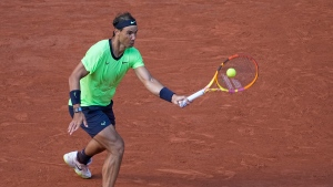 Nadal into quarterfinals, wins 35th straight set