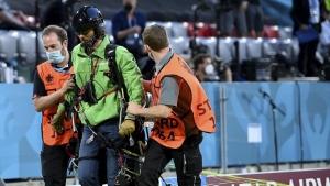 Greenpeace protestor parachutes into stadium at Euro 2020