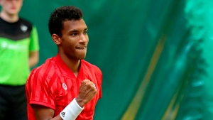 Auger-Aliassime advances to semifinals in Halle