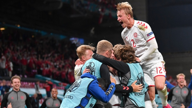 Denmark beats Russia to advance to Round of 16