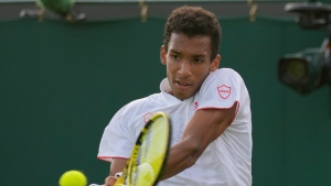 Auger-Aliassime through to Wimbledon third round with win over Ymer