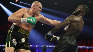 Report: COVID-19 outbreak in Fury's camp could postpone bout with Wilder