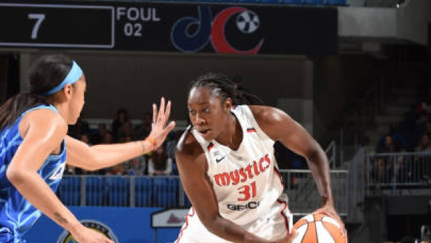 Charles has 34 points, 17 rebounds; Mystics top Sky in OT