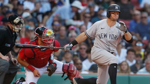 Odor, Yankees rally in 8th, end Boston's four-game win streak