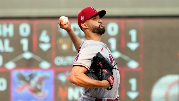 Sandoval has no-hit bid end in 9th; Angels beat Twins