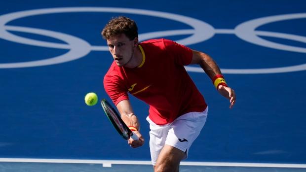 Carreno Busta upsets Djokovic to capture Olympic bronze