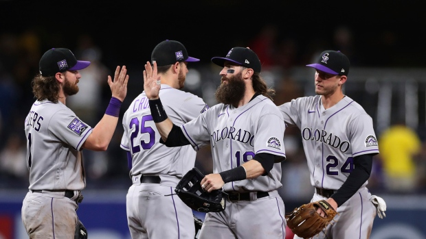 Márquez homers off Darvish, pitches Rockies past Padres